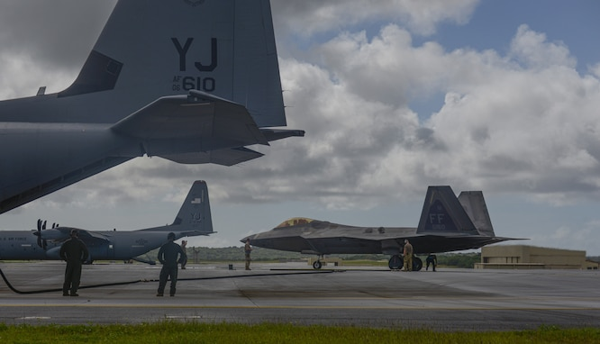 C-130J Super Hercules refuels F-22 Raptors using Aerial Bulk Fuel Delivery System