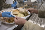 Airmen, Soldiers, veterans and their families gather for the Chaplains Thanksgiving Dinner Nov. 15, 2018 at Gowen Field, Boise, Idaho. The annual event is held to provide a free holiday meal and build esprit de corps amongst those who have served and are currently serving.
