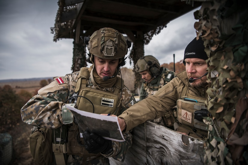 Joint Terminal Attack Controllers from the Latvian National Armed Forces conduct close air support training with U.S. Air Force A-10 Thunderbolt II aircraft assigned to the 107th Fighter Squadron, Selfridge Air National Guard Base, Mich., at Grayling Aerial Gunnery Range in Waters, Mich., October 29, 2019. Michigan and Latvia have been linked under the National Guard Bureau's State Partnership Program since 1993.