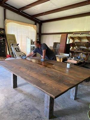 Aaron Boswell finishing a handmade table