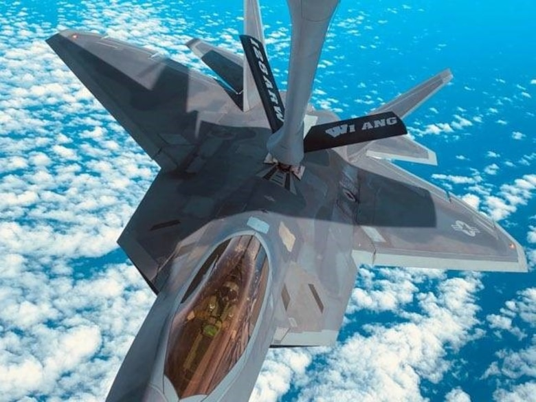 An F-22 Raptor, assigned to the 90th Fighter Squadron, Joint Base Elmendorf-Richardson, Ala., is refueled by a KC-135 Stratotanker assigned to the 128th Air Refueling Wing, Wisconsin Air National Guard, during Checkered Flag 21-1, Nov. 2, 2020.  Nineteen members of the 931st Air Refueling Wing, the Reserve component at McConnell Air Force Base, Kansas, participated in Checkered Flag, a large-scale aerial exercise hosted by the 325th Fighter Wing at Tyndall Air Force Base, Florida.  The exercise began Nov. 2, and ended Nov. 11.