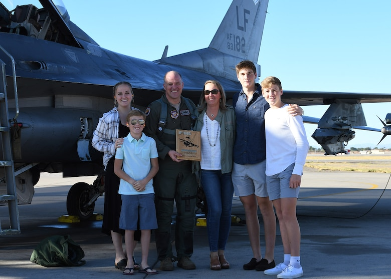 Col. Sean Rassas, 944th Fighter Wing vice commander, poses with his family in front of an F-16 Fighting Falcon following his 2,024th sortie Nov. 24, 2020, at Luke Air Force Base, Ariz.  During the flight, Rassas surpassed three thousand hours in the F-16, becoming one of only 296 U.S. Air Force pilots to reach that unique milestone.