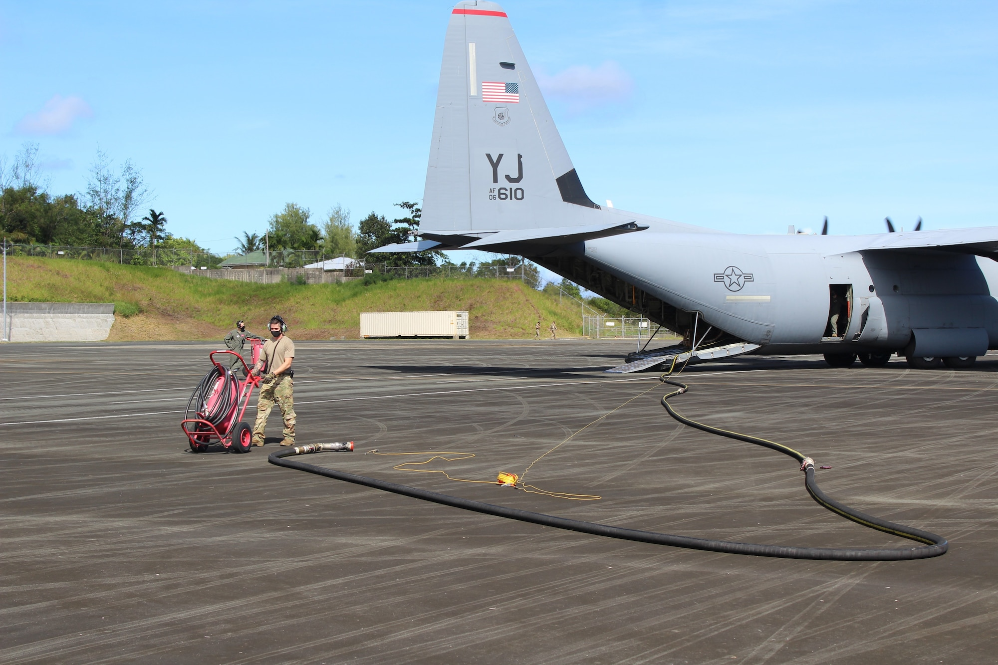 A U.S. Air Force Airman prepares to provide fuel to a U.S. Air Force C-130J assigned to the 36th Airlift Squadron, Yokota Air Base, Japan, during a Dynamic Force Employment on Palau, Nov. 24, 2020. DFE is an operational platform that allows our forces to be strategically predictable and operationally unpredictable. The United States security presence, along with our allies and partners, underpins the peace and stability that has enabled the Indo-Pacific region to develop and prosper for more than seven decades. (Courtesy Photo)