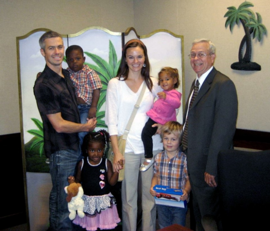 Maj. Matt Menendez and his wife, Evan, on adoption day in Florida, along with the judge who officiated the event. Front, left to right, Nya, age 4, and Zack, 4. Second row, Lenny, 3, and Kimmie. (Courtesy photo)