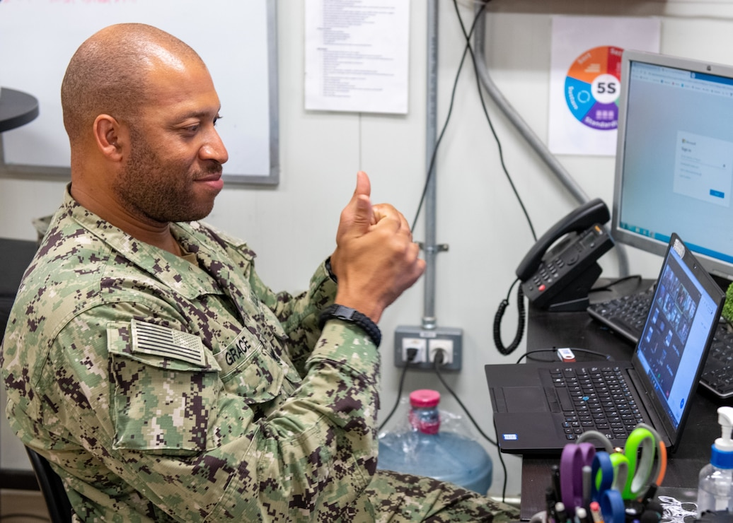 Logistics Specialist 2nd Class Cortney Grace participates in a zoom call with Chairman of the Joint Chiefs of Staff Gen. Mark Milley at Camp Lemonnier, Djibouti.