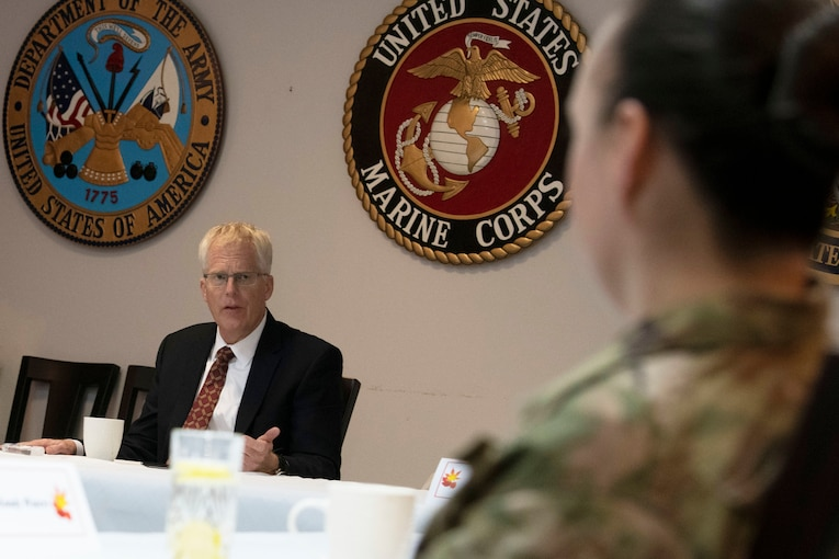 Acting Defense Secretary Christopher C. Miller talks to a service member.