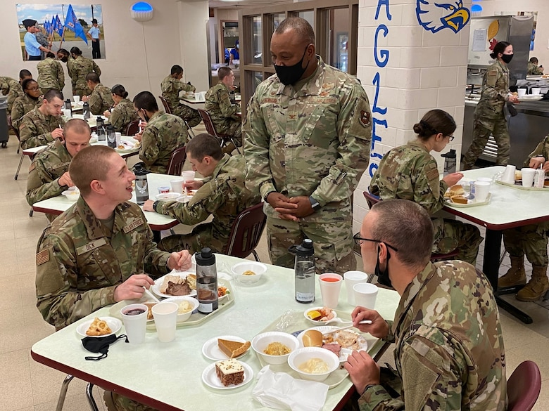 Airmen who graduated from Basic Military Training on Nov. 25 enjoy their first Thanksgiving meal in uniform at Joint Base San Antonio-Lackland, Texas, on Nov. 26.