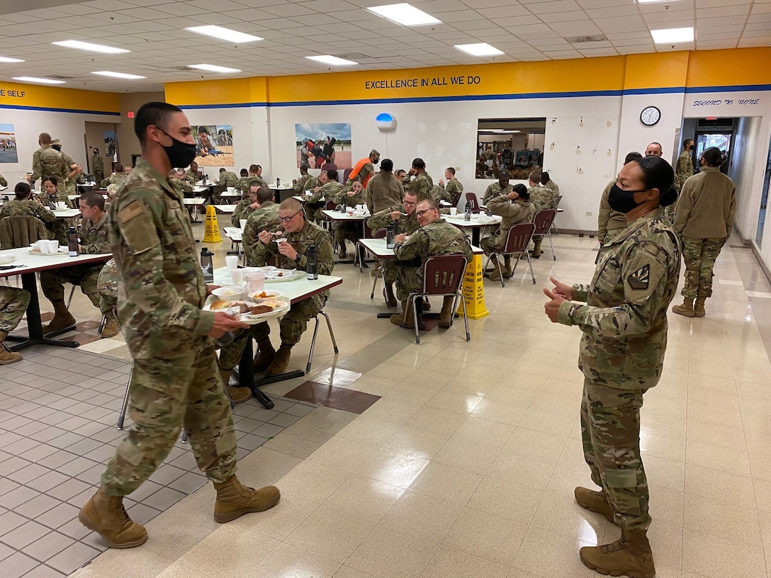 Airmen who graduated from Basic Military Training on Nov. 25 enjoy their Thanksgiving Day meal on Nov. 26 before shipping out to their respective technical training bases on Nov. 27.