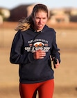Master Sgt. Bonnie Ross, 7th Space Operations Squadron, works her way uphill after the final turn of the 19th annual Turkey Trot race Nov. 20, 2020, at Schriever Air Force Base, Colorado. Ross was the first female competitor to finish and did so in 22 minutes, 2 seconds.  (U.S. Space Force photo by Marcus Hill)