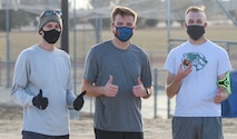 Member of the 6th Space Operations Squadron give thumbs up after completing the 19th annual Turkey Trot race Nov. 20, 2020, at Schriever Air Force Base, Colorado. The 50t Force Support Squadron provided T-shirts to all who finished the race. From left are 6th SOPS's Paul Deutsch, Forrest Templin and Brendyn Baker. (U.S. Space Force photo by Marcus Hill)