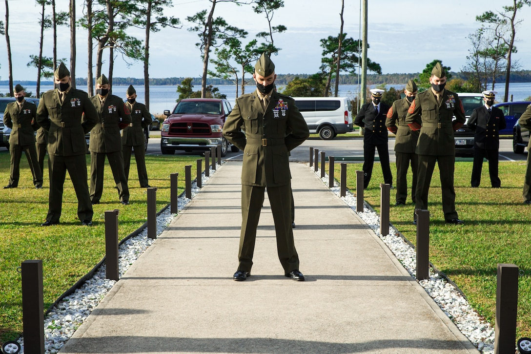 U.S. Marines bow their heads during the invocation at a French Fourragrere dedication ceremony on Camp Lejeune, N.C., Nov. 25.