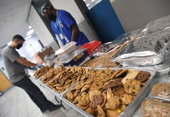 Airmen from the 81st Training Group sort cookies inside the Levitow Training Support Facility at Keesler Air Force Base, Mississippi, Nov. 26, 2020. Due to the concern over rising COVID-19 cases, 81st TRG students weren't allowed to leave Keesler for the holidays. Keesler personnel were asked to donate cookies to the students to increase moral.(U.S. Air Force photo by Kemberly Groue)