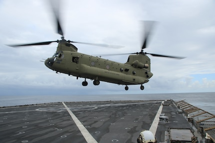 A CH-47 Chinook helicopter takes off from the flight deck of USS Comstock (LSD 45) in support of U.S. Southern Command's Hurricane Iota relief efforts in Central America.