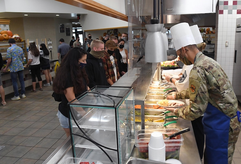 Keesler leadership serves lunch to 81st Training Group students inside the Azalea Dining Facility at Keesler Air Force Base, Mississippi, Nov. 26, 2020. It is tradition at Keesler for commanders, first sergeants and superintendents to serve a Thanksgiving meal at the dining facility to technical training and permanent party Airmen who are not able to go home for the holiday. (U.S. Air Force photo by Kemberly Groue)