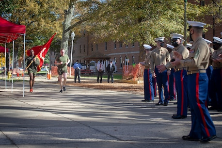Headquarters Battalion Marines finish mile 245 during a cake cutting ceremony for the 245th Marine Corps Birthday at Yale Hall, Quantico, Va., Nov. 10, 2020.