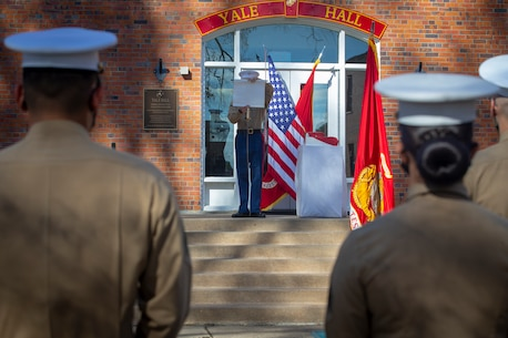 A U.S. Marine reads Gen. John A. Lejeune's birthday message during Training and Education Command's cake cutting ceremony.