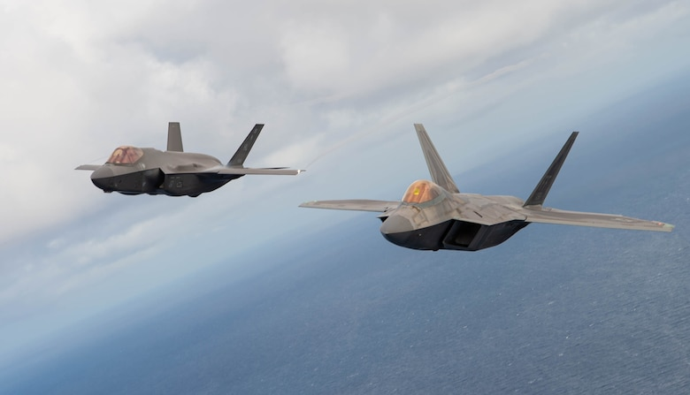 An F-22 Raptor and F-35A Lightning II fly in formation near Fort Lauderdale, Fla., Nov. 20, 2020. The fighter jets, along with the C-17 West Coast Demo Team from Joint Base Lewis-McChord, Wash., participated in the two-day 2020 Fort Lauderdale Air Show. (U.S. Air Force photo by Senior Airman Tryphena Mayhugh)