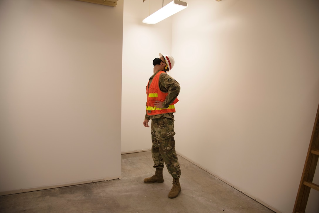 During the 2018 quake, walls inside the building fell and some exterior walls cracked running from the foundation to the roofline. In total, the damages cost about $4 million. The project was completed in October 2020. Shown here, Capt. Justin Dermond, USACE - Alaska District project engineer, inspects one of the repaired walls at the People Center.