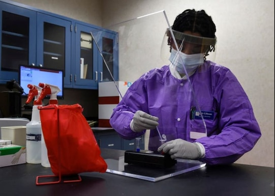 Tech Sgt. Jonisha Gibson, 82nd Medical Group clinical laboratory noncommissioned officer in charge, prepares a sample for diagnostic testing at Sheppard Air Force Base, Texas, April 9. Since the establishment of the Department of the Air Force Acquisition COVID-19 Task Force in late March, the Digital Directorate has been assisting the Department of Health and Human Services in awarding contracts aimed at boosting the domestic production of COVID-19 testing equipment and supplies. (U.S. Air Force photo by Senior Airman Pedro Tenorio)