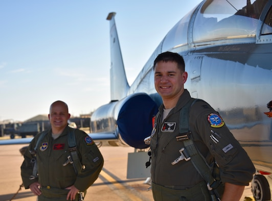 Lt. Col. Adam Markel, left, a seasoned F-16 seasoned fighter pilot, and Capt. Richard Bergeron, an Introduction to Fighter Fundamentals instructor pilot, pose for a photo at Sheppard Air Force Base, Texas, Nov. 18, 2020. Bergeron was 29 which exceeded the age requirement to begin his career in a rated field. Despite this, he decided he still wanted to try to earn a commission and chose to build off of his enlisted experience and become an intelligence officer. (Courtesy Photo)