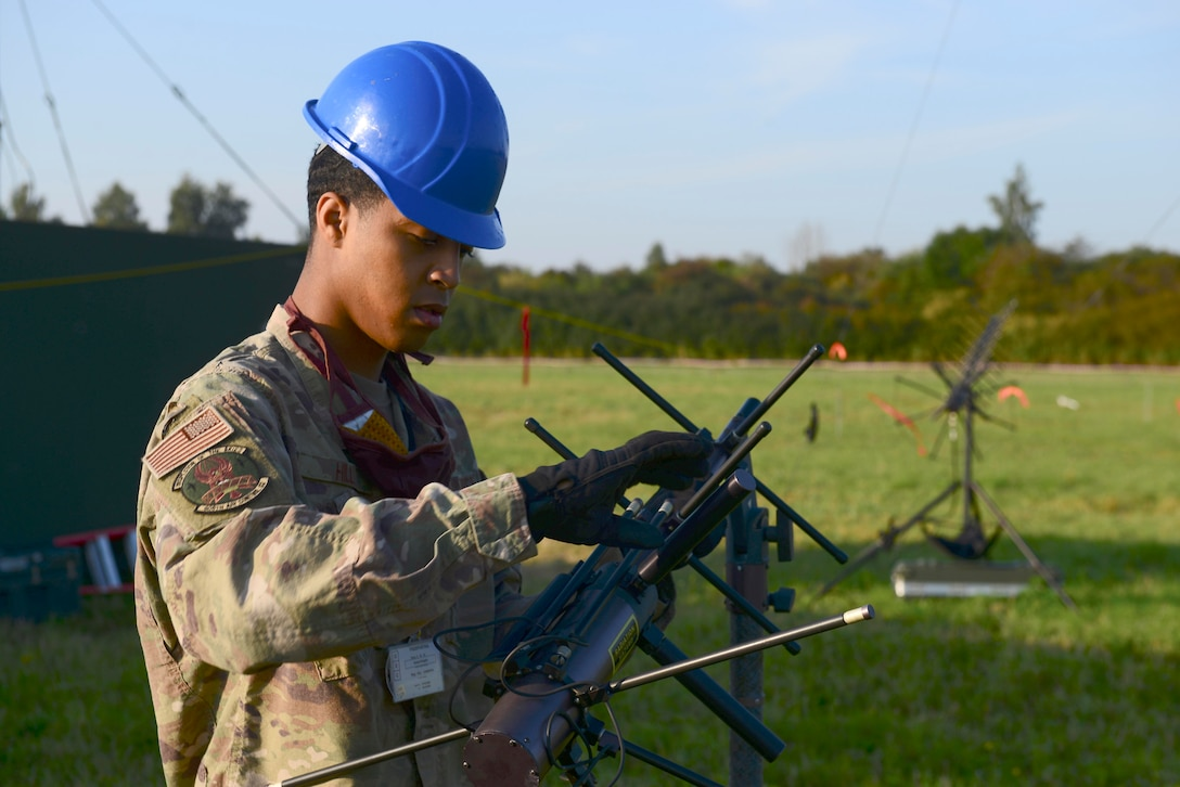 U.S. Air Force Staff Sgt. Cameron Hill, 606th Air Control Squadron plans and programs, deconstructs an AV211 antenna during exercise Astral Knight 20 at Malbork Air Base, Poland, Sept. 23, 2020. The 606th ACS was responsible for providing tactical command and control during the exercise. (U.S. Air Force photo by Tech. Sgt. Tory Cusimano)