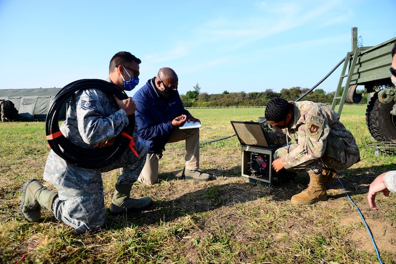 Members of the 606th Air Control Squadron radio frequency transmissions section conduct training on a high frequency coupler during exercise Astral Knight 20 at Malbork Air Base, Poland, Sept. 23, 2020. AK20 enhances our professional relationships and improves overall coordination with allies and partner militaries during times of crisis.(U.S. Air Force photo by Tech. Sgt. Tory Cusimano)