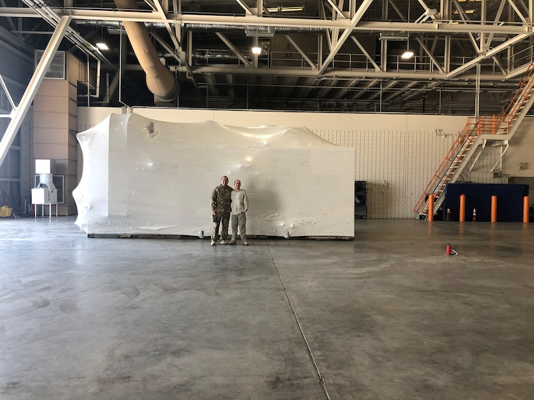 Maj. Eric Chase (right) and Chief Master Sgt. Ismael Paez (left), both functional program managers, played key roles in the effort to move the hypobaric altitude chamber to Joint Base San Antonio-Lackland, Texas. (Courtesy photo).