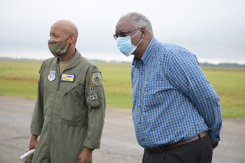 Col. Jaron Roux, 437th Airlift Wing commander, left, and Mayor Julius Jones, mayor of North S.C., right, stand on the runway of North Auxiliary Airfield Sept. 28, 2020, in North, S.C. While visiting NAAF, Joint Base Charleston leadership toured the infrastructure and facilities of the 2,400 acre airfield on the outskirts of a town with a population of less than 1,000 people and discussed the strategic advantage the training ground plays for Joint Base Charleston, Air Mobility Command, the DoD and other mission partners. (U.S. Air Force photo by Senior Airman Joshua R. Maund)