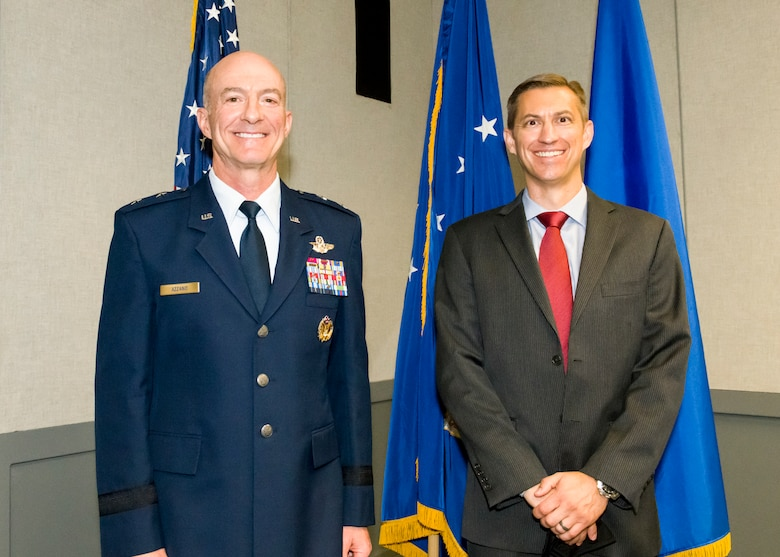 Air Force Test Center Commander, Maj. Gen. Christopher Azzano, stands next to Christopher Klug, the new Multi-Domain Test Force Detachment 1 director.