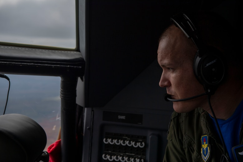 The 62nd Airlift Squadron commander looks out of the cockpit on a C-130.