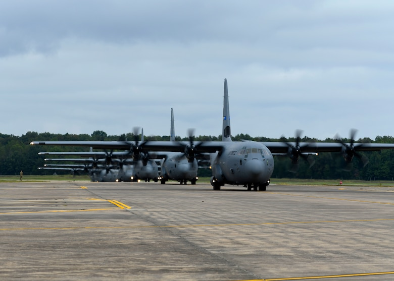 C-130s taxi down the flight line.