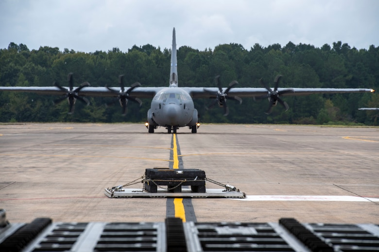 Aircrew from the 314th Airlift Wing conduct a combat offload on the flight line
