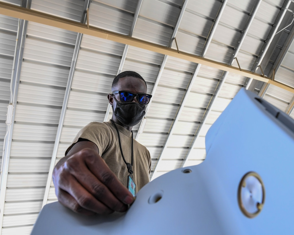 Airman Haji Williams, 56th Equipment Maintenance Squadron munitions systems technician, prepares a GBU-12 Paveway II laser-guided bomb tail kit for installation Sept. 20, 2020, at Luke Air Force Base, Arizona.