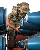 Airman 1st Class Tyler Drummund,  56th Equipment Maintenance Squadron munitions systems technician, removes shipping caps from GBU-12 Paveway II laser-guided bombs Sept 22, 2020, at Luke Air Force Base, Arizona.