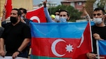 Demonstrators holding Azeri and Turkish flags shout slogans during a protest against Armenia near the Consulate of Azerbaijan in Istanbul, Turkey, Sept. 29, 2020.
