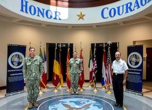 Vice Adm. Dave Kriete, outgoing director, Combined Joint Operations from the Sea Center of Excellence (CJOS COE), left, Vice Adm. Andrew Lewis, oncoming director, CJOS COE, center, and Royal Navy Commodore Thomas Guy, deputy director CJOS COE, participated in a ceremonial photograph in support of the transition of directorship from deputy commander, U.S. Fleet Forces Command to Commander, U.S. 2nd Fleet.