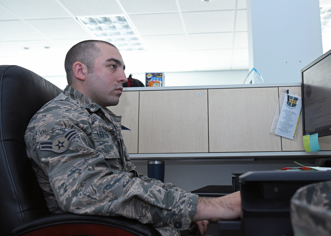 Airman 1st Class Justin Lefevre, 9th Contracting Squadron contract specialist, works on his computer Sep. 23, 2020 at Beale Air Force Base, California. Contract specialists help prepare, negotiate and award contracts to qualified vendors. (U.S. Air Force photo by Airman 1st Class Luis A. Ruiz-Vazquez)