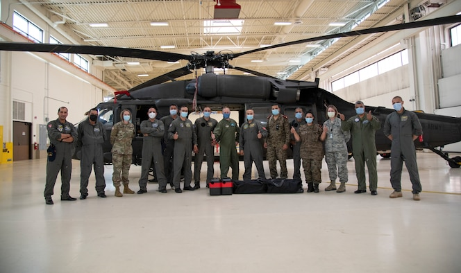 Members from the Tunisian Air Force and Wyoming National Guard in front of a UH-60 Black Hawk helicopter at the Army Aviation Support Facility on F. E. Warren Air Force Base, Cheyenne, Wyo., Sept. 16, 2020. The Tunisians attended the Aviation Familiarization Event hosted by the Wyoming National Guard under the State Partnership Program. =