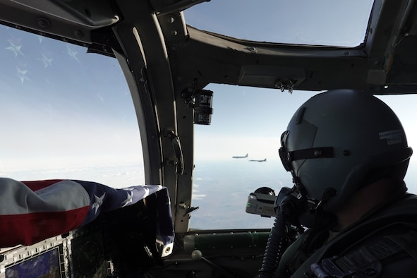 Photo of a B-1 Lancer pilot looking out of window.