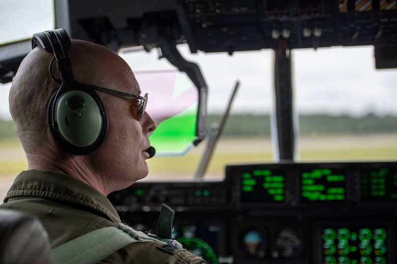 The 314th commander looks out of the cockpit of a C-130J.