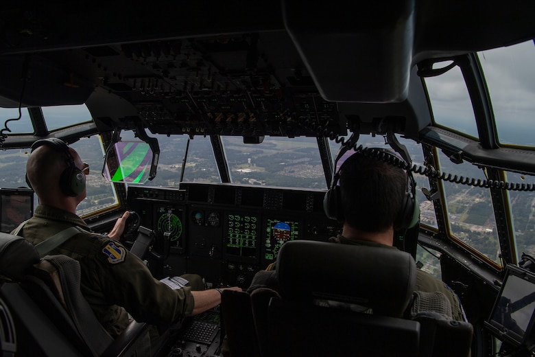 Two pilots fly over Arkansas during a training exercise.