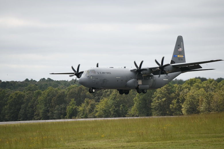 A C-130 takes off from All American drop-zone.