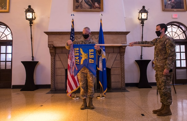 image of the 17th special tactics squadron's transition ceremony at a hall in Fort Benning, Georgia
