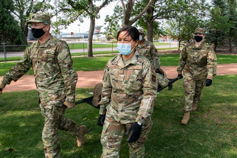Reserve Citizen Airmen with the 932nd, 910th and 302nd Airlift Wings participate in Operation Centennial Summit at Peterson Air Force Base, Colorado. The exercise gave members the opportunity to get hands-on training in areas like  litter carry procedures, triage, self-aid and buddy care and  respiratory distress. (Senior Airman Brooke Spenner)