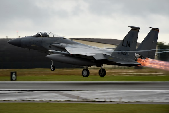 An F-15C Eagle, assigned to the 493rd Fighter Squadron, takes off at Royal Air Force Lakenheath, England, in support of Mission Assurance Exercise 20-20, Sept. 29, 2020. MAX 20-20 is designed to test and hone capabilities for conducting operations in conventional and chemical warfare environments while integrating the Agile Combat Employment concept, which applies the use of agile operations to generate resilient airpower in a contested environment. (U.S. Air Force photo by Senior Airman Christopher S. Sparks)