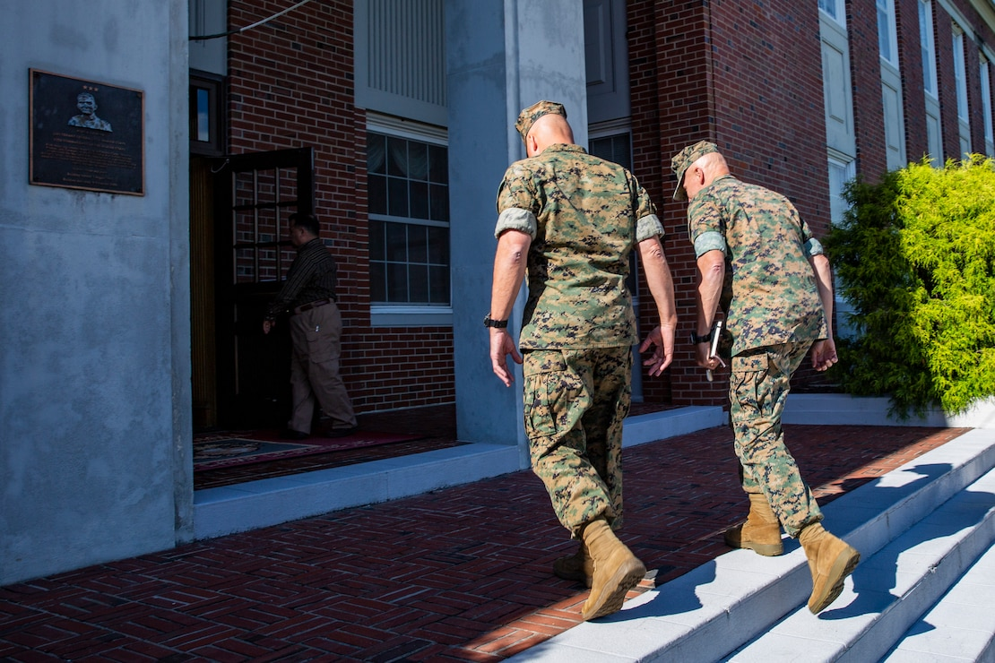 U.S. Marine Corps Maj. Gen. Julian D. Alford, left, commanding general, Marine Corps Installations East-Marine Corps Base Camp Lejeune, escorts Lt. Gen. Charles G. Chiarotti, right, deputy commandant, Installations and Logistics, into Bldg. 1 during his visit to MCB Camp Lejeune, North Carolina, Sept. 30, 2020. Chiarotti and Maj. Gen. Edward D. Banta, commander, Marine Corps Installations Command visited Camp Lejeune and other MCIEAST installations in Eastern North Carolina to receive updates on the progress of hurricane-related construction projects and repairs. (U.S. Marine Corps photo by LCpl. Christian Ayers)