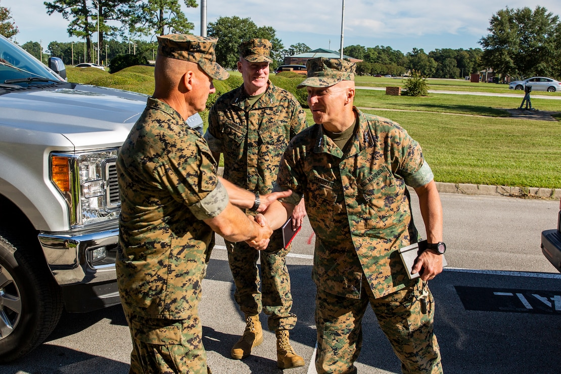 U.S. Marine Corps Lt. Gen. Charles G. Chiarotti, right, deputy commandant, Installations and Logistics, and Major General Edward D. Banta, center, commander, Marine Corps Installations Command are greeted by Maj. Gen. Julian D. Alford, left, commanding general, Marine Corps Installations East-Marine Corps Base Camp Lejeune, during their visit to MCB Camp Lejeune, North Carolina, Sept. 30, 2020. Chiarotti and Banta visited Camp Lejeune and other installations in Eastern North Carolina to receive updates on the progress of hurricane-related construction and repair projects. (U.S. Marine Corps photo by LCpl. Christian Ayers)