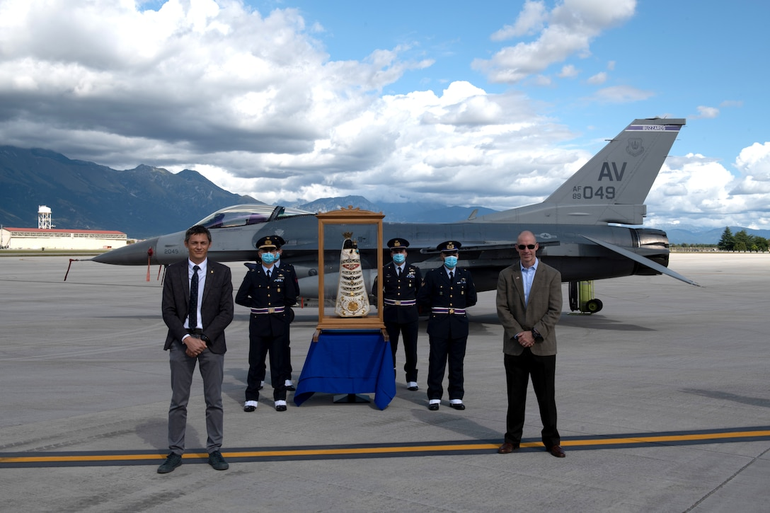 U.S. Air Force Brig. Gen. Jason Bailey, 31st Fighter Wing commander, right, and Italian air force Col. Luca Crovatti, Italian base commander, pose for a photo with a Madonna Di Loreto statue at Aviano Air Base, Italy, Sept. 27, 2020. Madonna Di Loreto was designated as the Patroness of Aeronauts in 1920 by Pope Benedict XV. (U.S. Air Force photo by Senior Airman Caleb House)