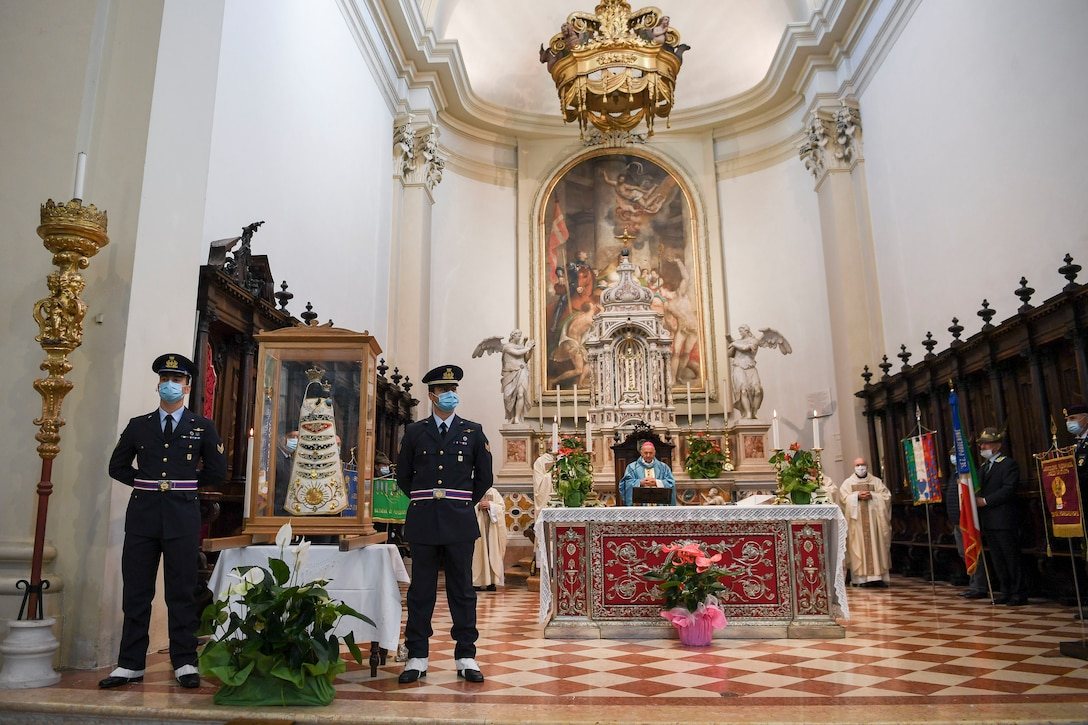 Two Italian air force members stand guard by a Madonna Di Loreto statue during holy mass in Pordenone, Italy, Sept. 29, 2020. The Madonna Di Loreto is the Patroness of Aeronauts, as declared by Pope Benedict XV. (U.S. Air Force photo by Staff Sgt. Savannah L. Waters)
