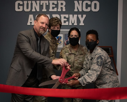 Gunter NCOA staff cut the ribbon leading to the new Gunter NCOA